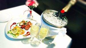 Indian Empire table laid with cutlery, champagne and fine food thumbnail