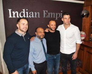 Uddin with Mike Phillips and Rhys Williams at Indian Empire Restaurant