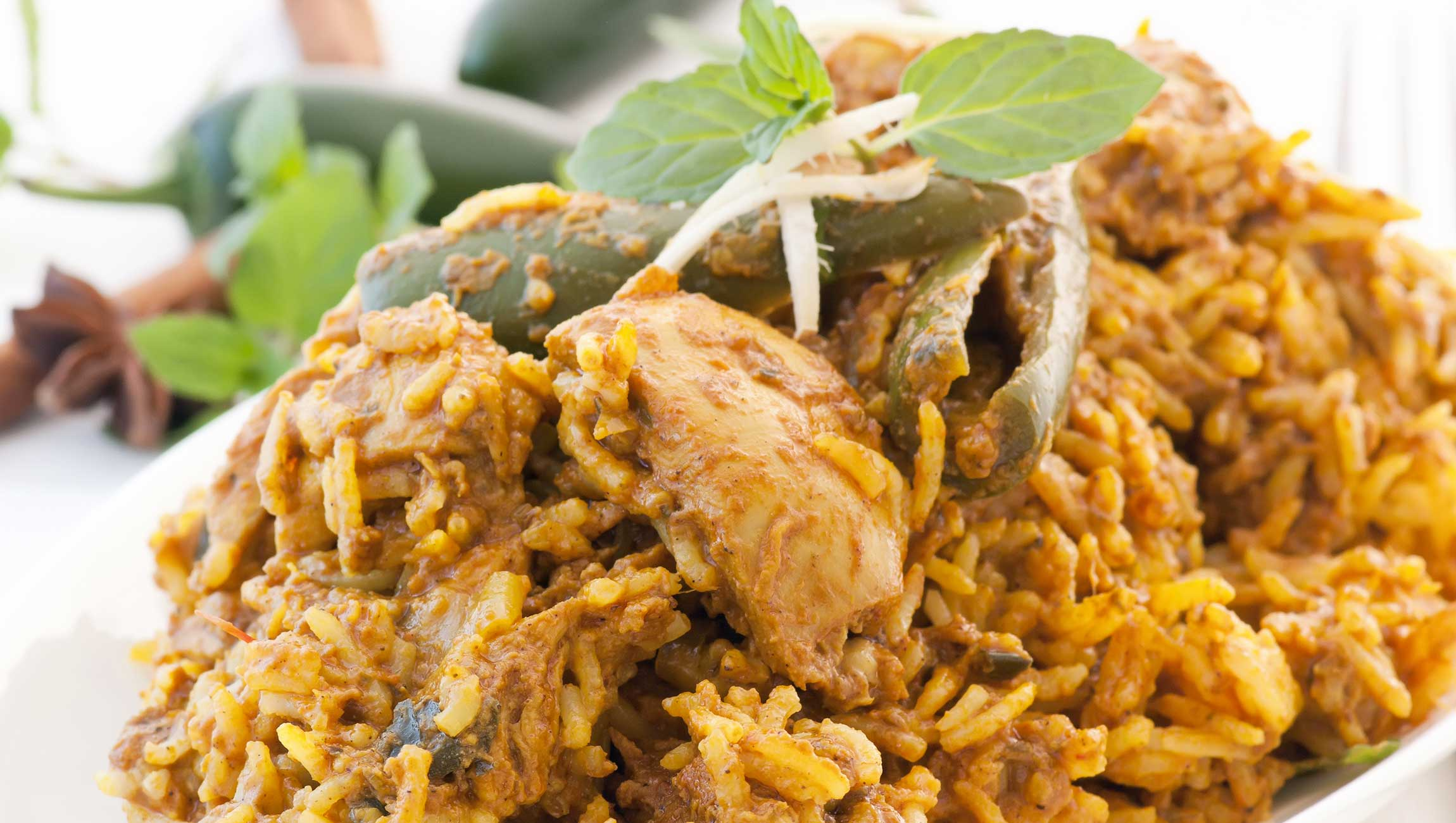 indian cuisine dish with chicken rice and chillies